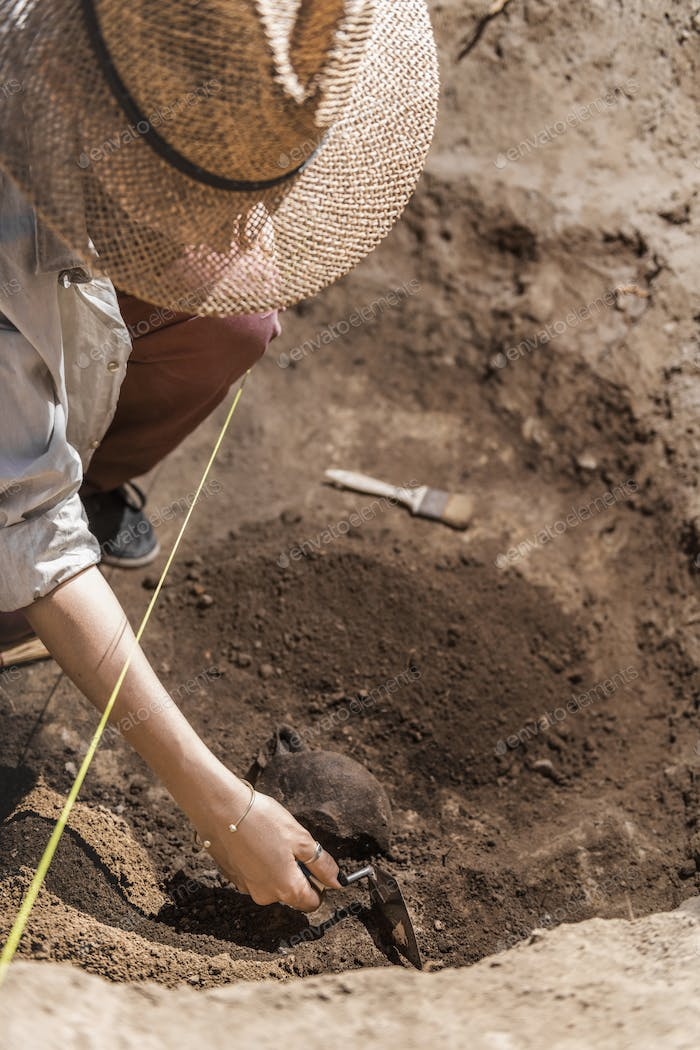 Archaeologist Uncovers Ancient Pottery Object
