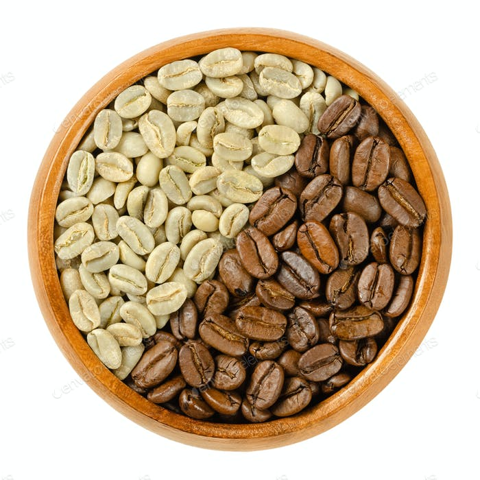 Green and roasted Arabia coffee beans in wooden bowl