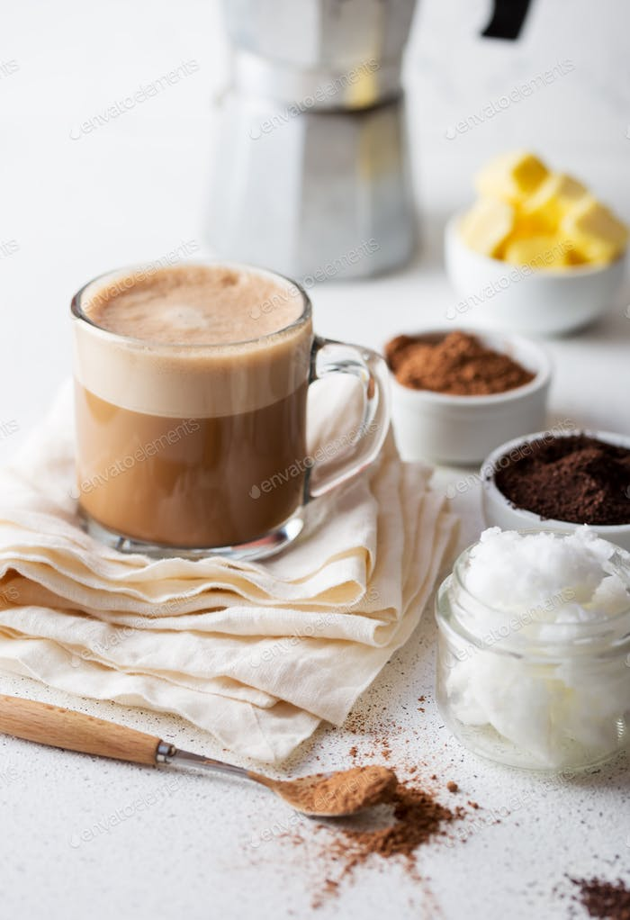 Ketogenic diet drink. Cup of bulletproof coffe with cacao and ingredients