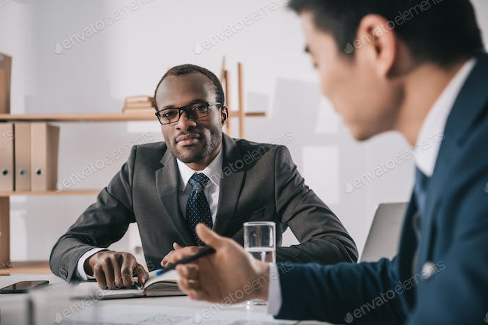 business colleagues having conversation in modern office