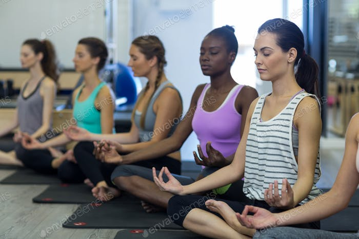 Group of women practicing yoga