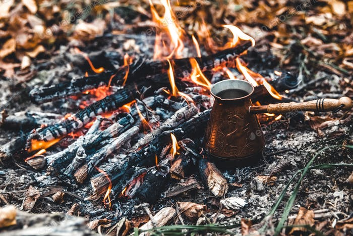Thumbnail for Making coffee at the stake. Make coffee or tea on the fire of nature. Burned fire. A place for fire