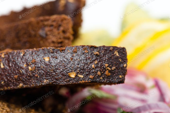 Thumbnail for Grilled rye bread and marinated red onion.