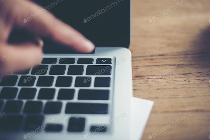 Woman hands finger point pushing into shutdown button