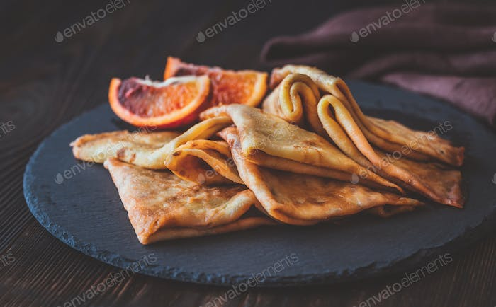 Crepes Suzette on the stone board