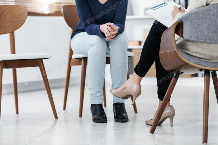Anonymous photo of two women during group psychotherapy for people with depression