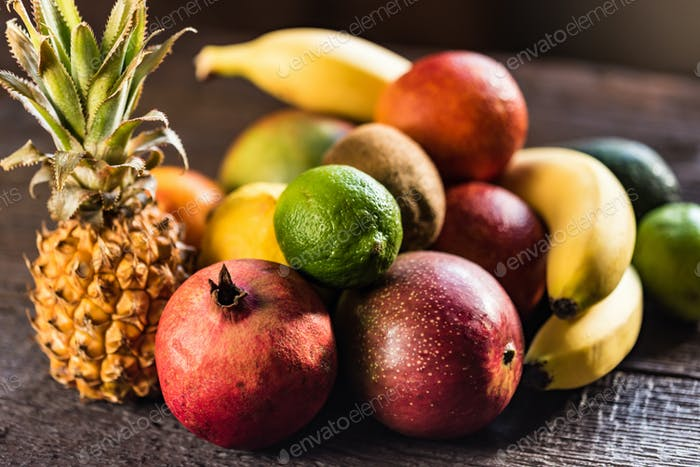 Studio shot of various exotic fruit on wood
