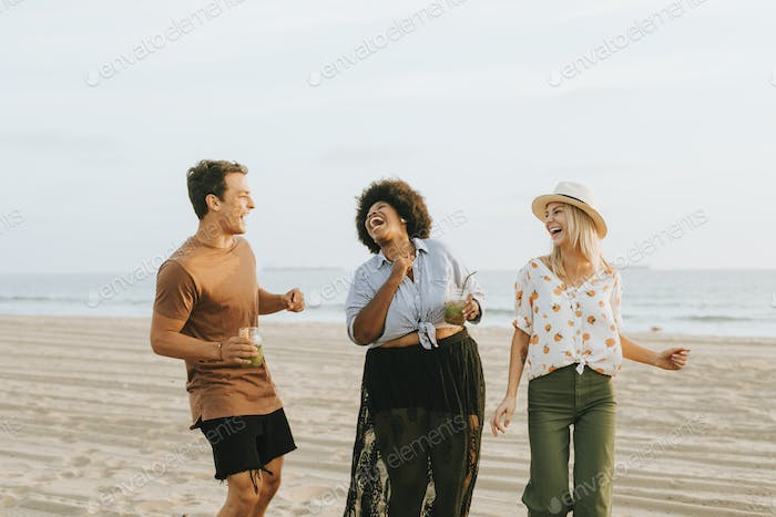 Friends dancing and having fun at the beach