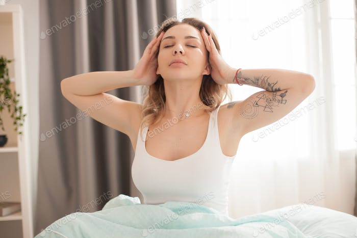 Pretty caucasian woman stretching in the morning