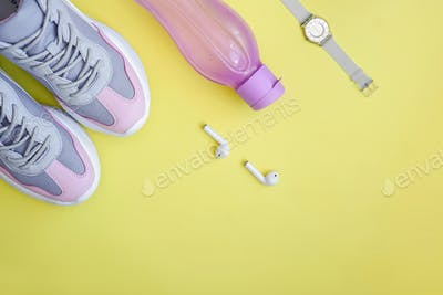 Flat lay sport on yellow background.