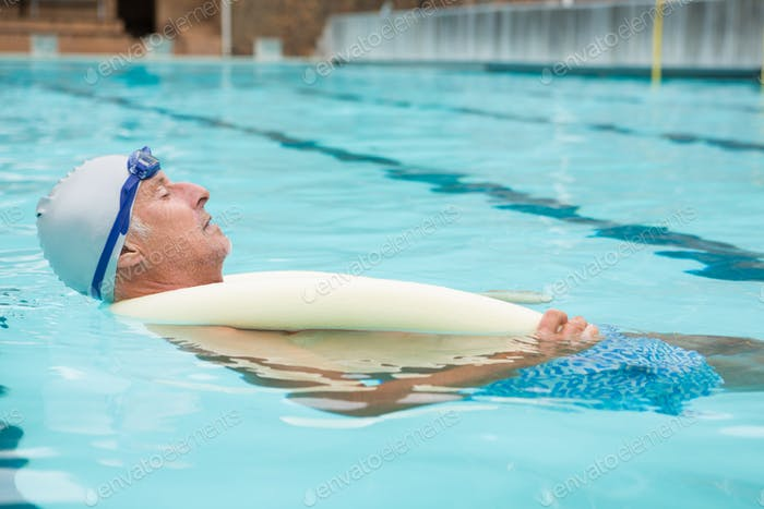 Senior man swimming in pool