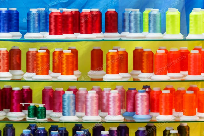 Spools of new color threads, sewing equipment