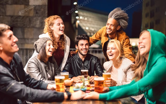 Happy people drinking beer at brewery bar outdoors