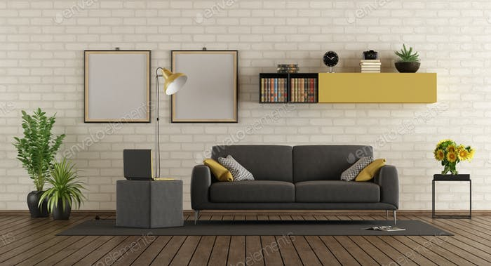 Modern living room with sofa and brick wall