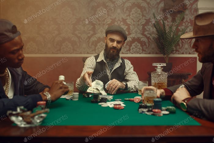 Poker player makes the bet, casino
