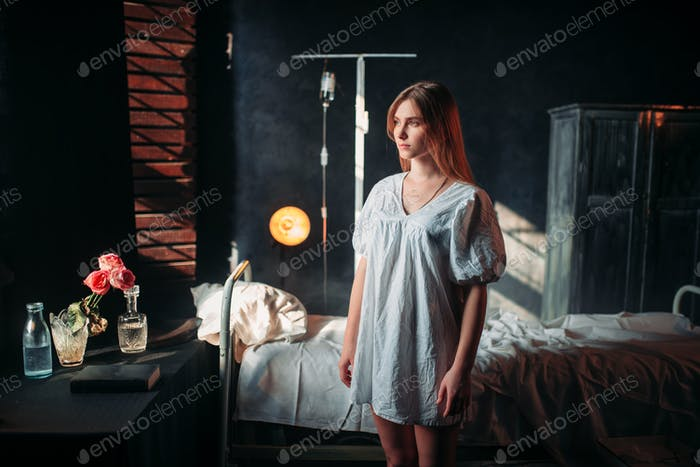 Ill woman in hospital, drip and bed on background