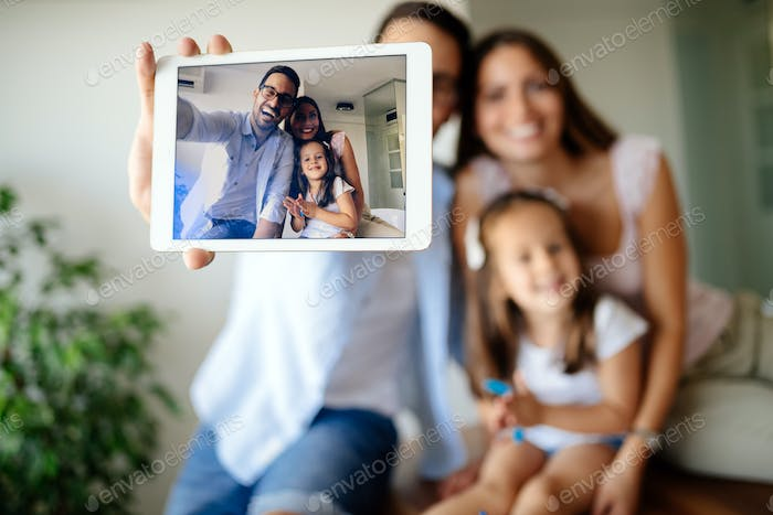 Happy family taking selfie in their house