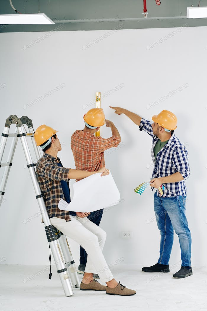 Workers Checking Wall Level