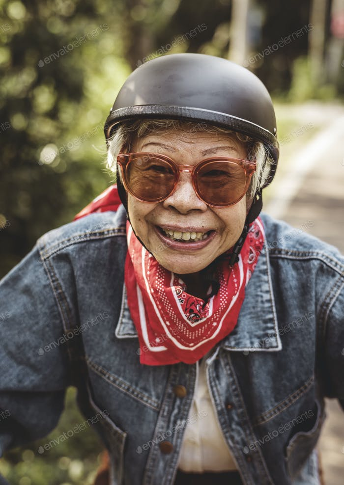 Happy woman riding a classic scooter