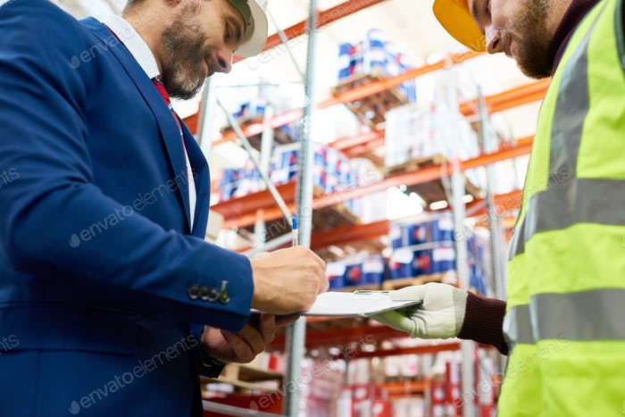 Inspector Signing Document in Warehouse