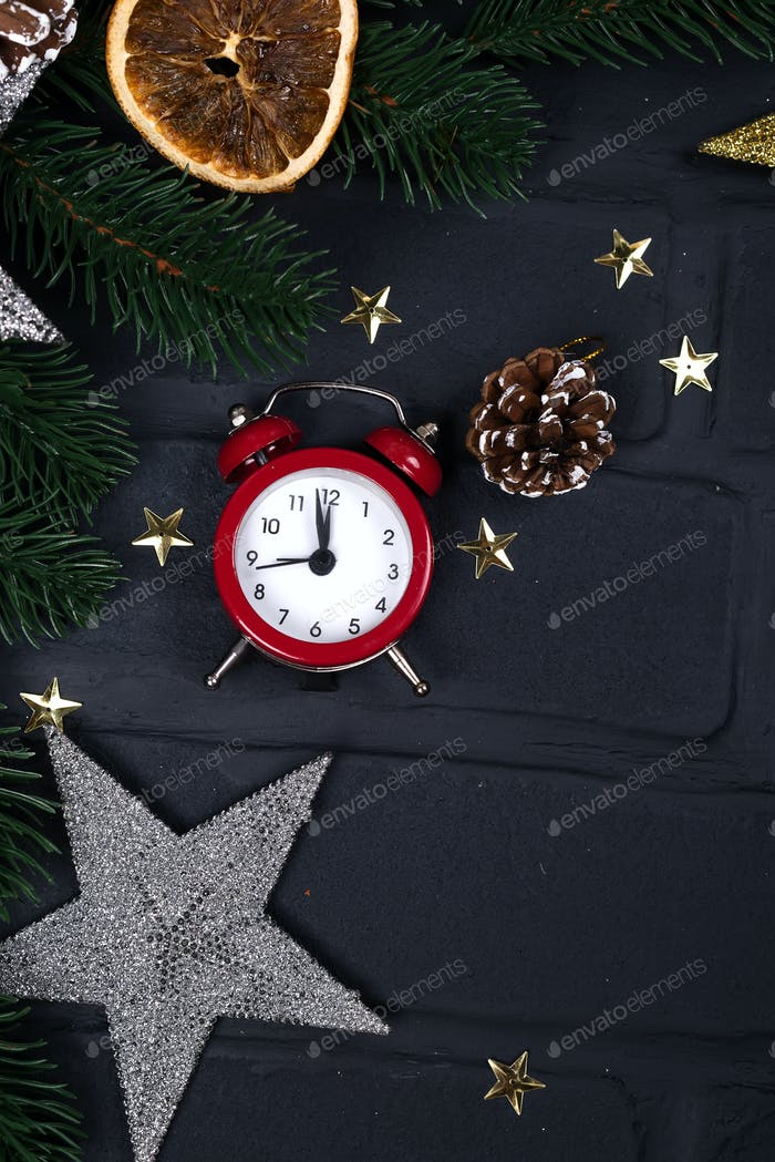 Xmas greeting card. Christmas background with toys and alarm clock. View from above
