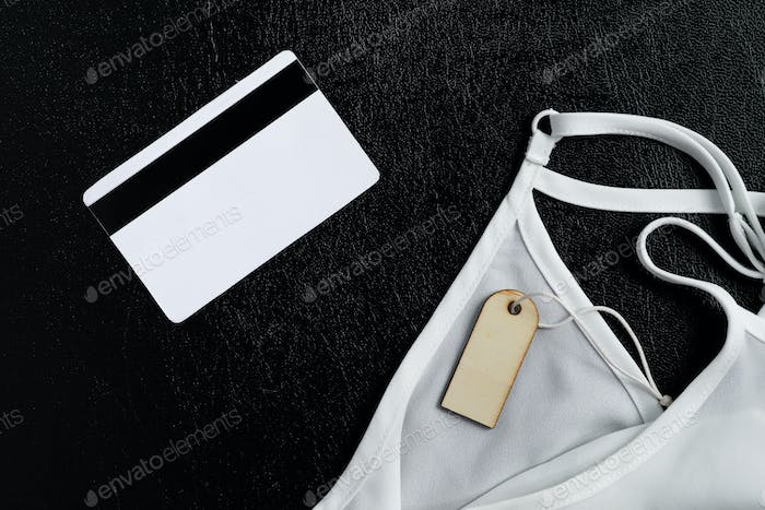 Simple Tag Mockup , credit tag and white silk undershirt on black