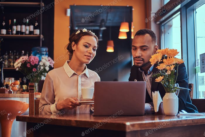 Attractive African-American couple at a business meeting in the restaurant