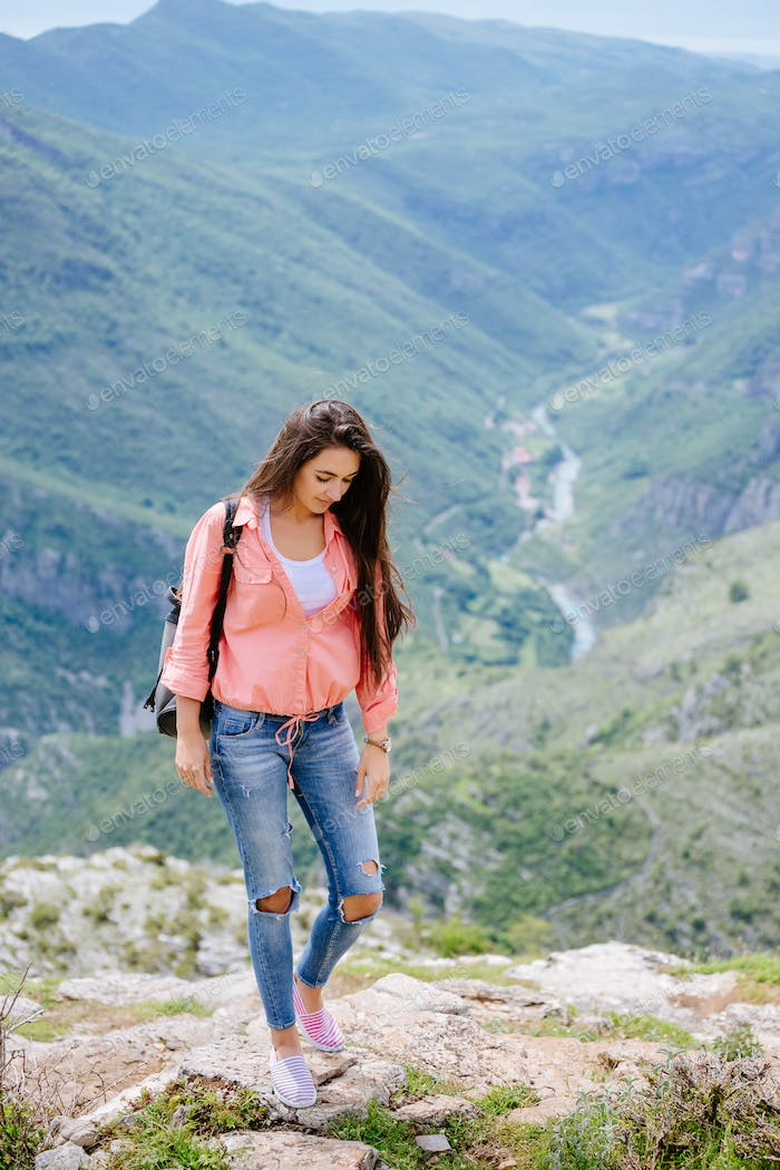 woman travel mountains with backpack