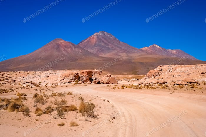 Sandy and gravel desert road through southern Altiplano