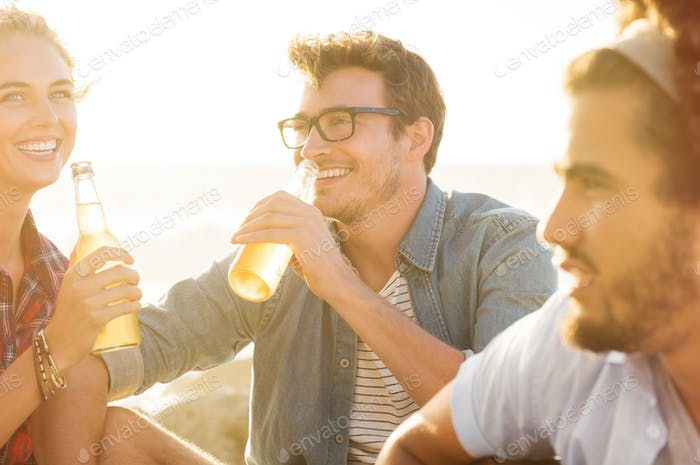 Happy friends drinking