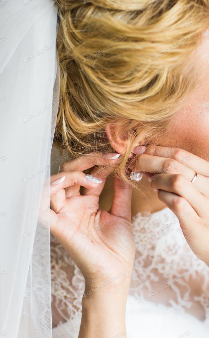 close-up of beautiful woman wearing shiny diamond earrings