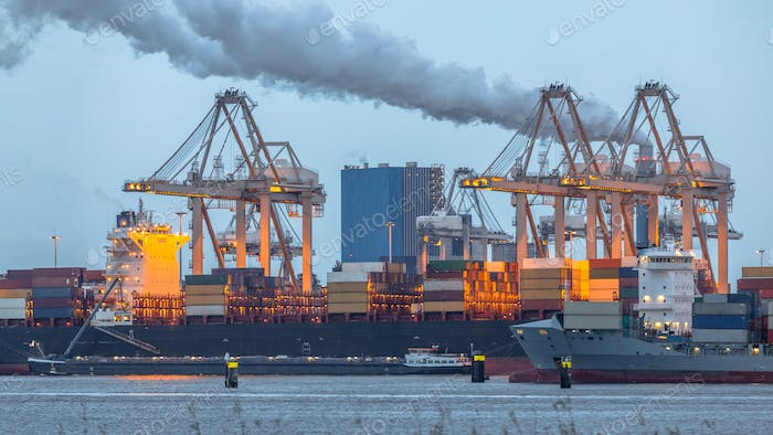 Container ships loading at Port of Rotterdam