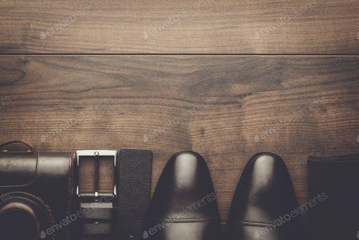 brown shoes, belt, socks and film camera