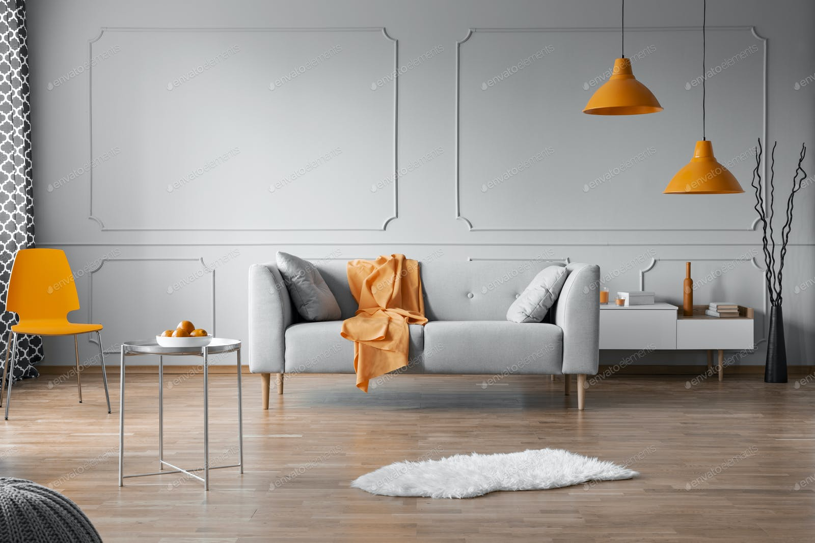 Orange accents in grey living room interior with copy space on empty wall  photo by bialasiewicz on Envato Elements