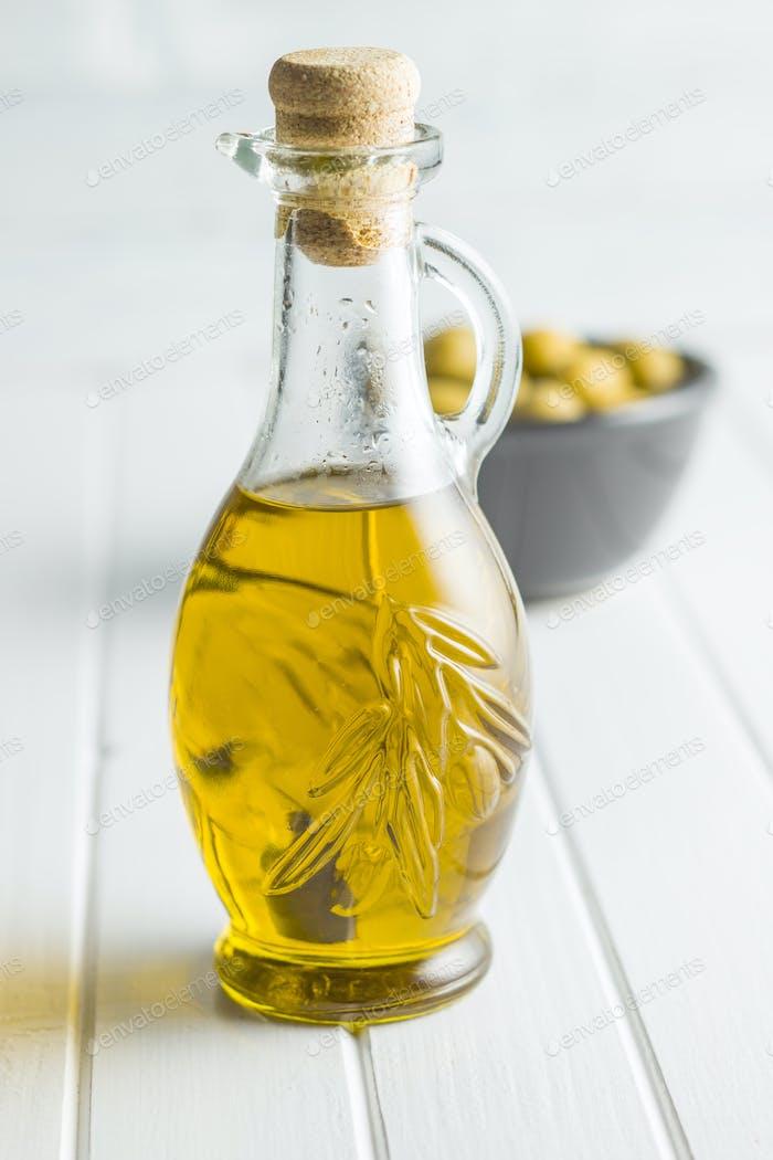 Olive oil in bottle.