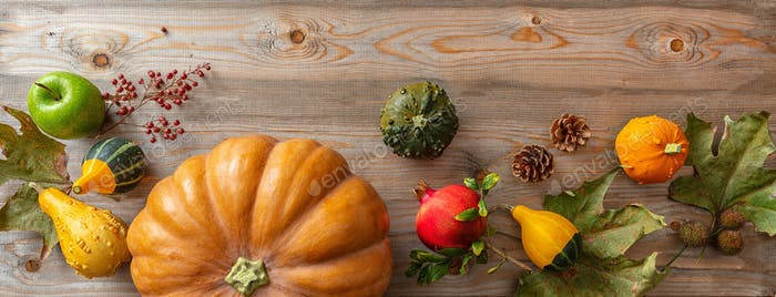 Thanksgiving flat lay with colorful pumpkins, fruits and fall leaves