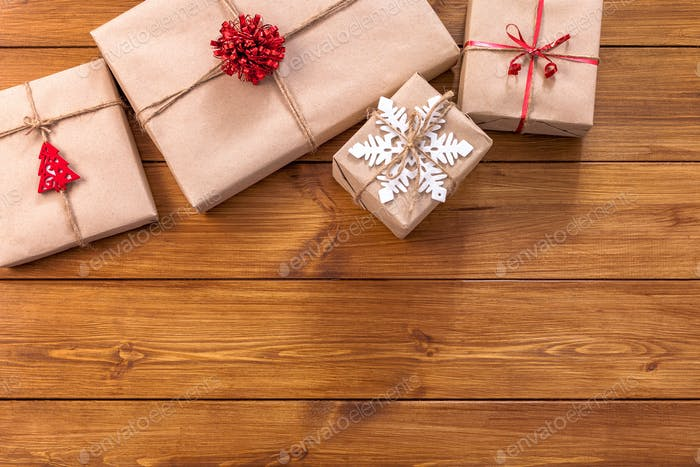 Christmas gift boxes on wood frame background
