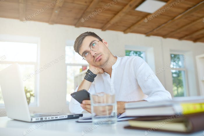 thoughtful handsome young businessman