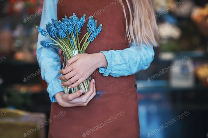 Young woman with blue muscari