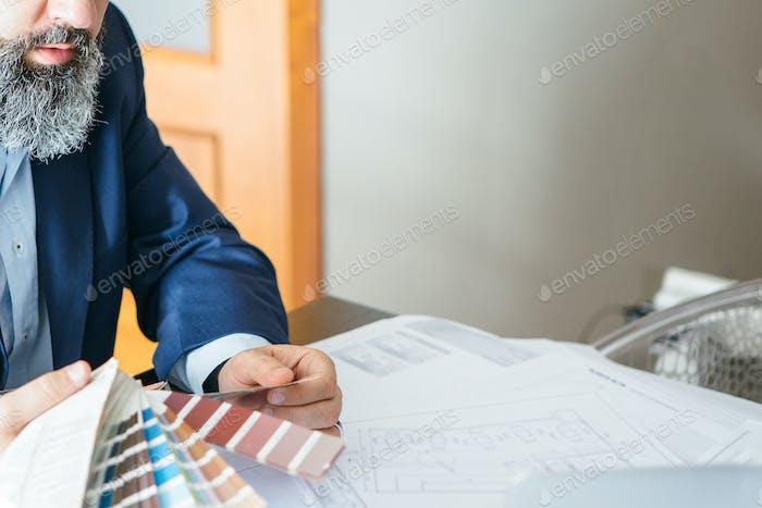 Man with designer palette