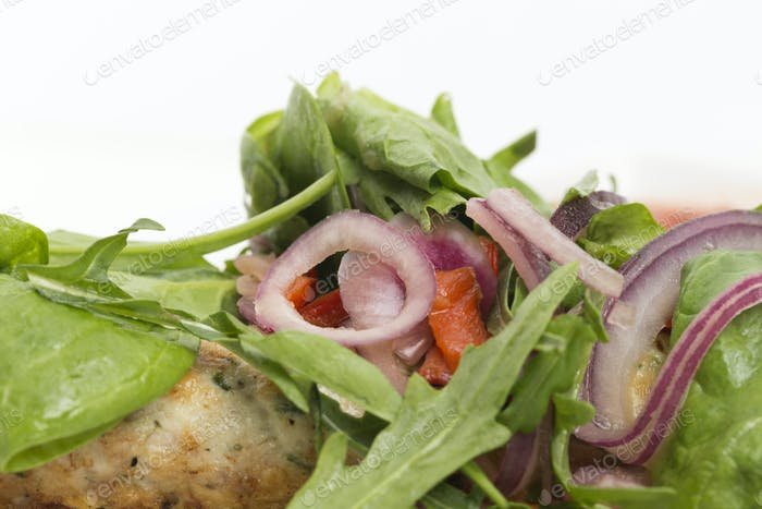 Fragment of dish chicken kebab and a salad. This image may be used as a background. Close-up.