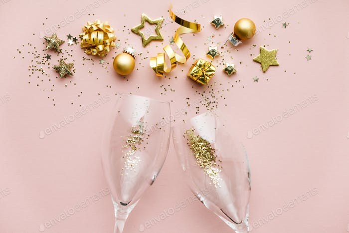 Flat lay of Celebration. Champagne glasses and Christmas decoration