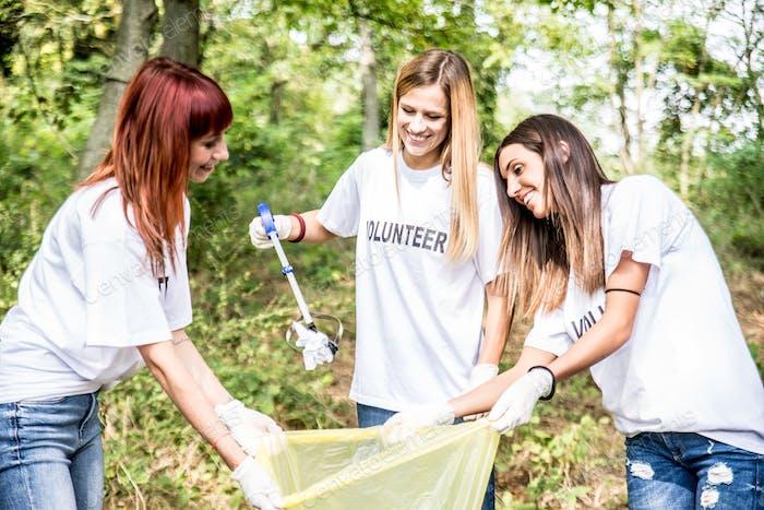 Volunteers cleaning garbage