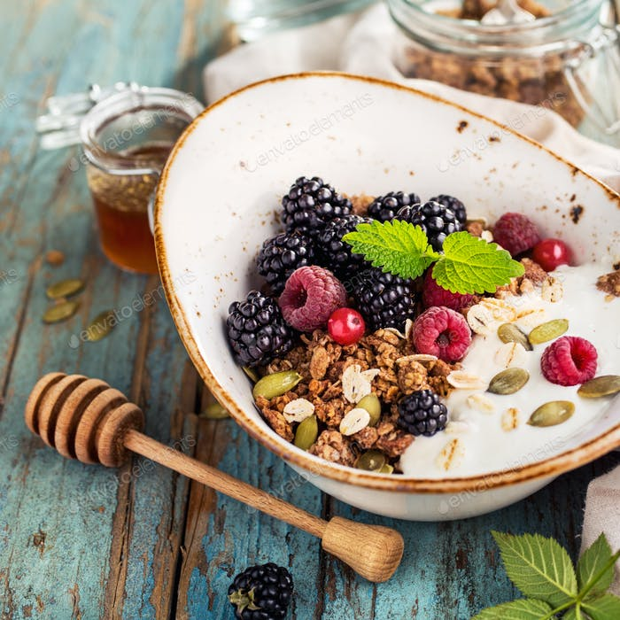 Granola with blackberry, close-up