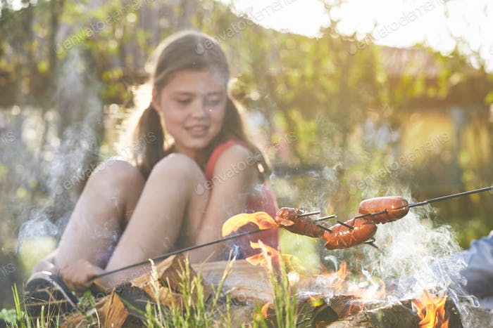 Girl enjoy campfire