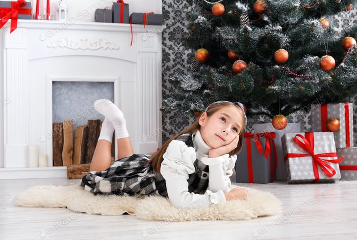 Beautiful child girl in christmas interior