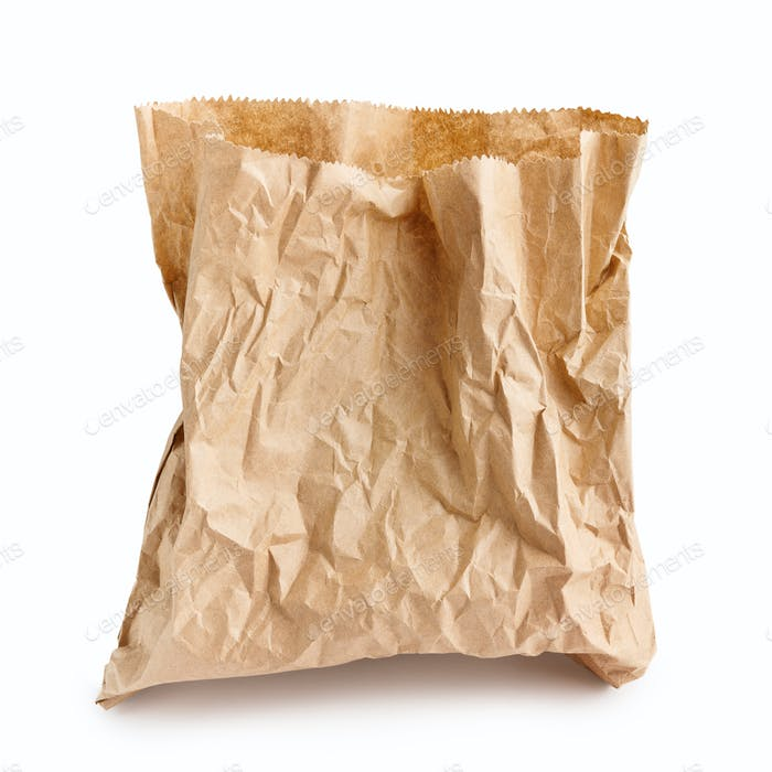 Crumpled paper bag on white