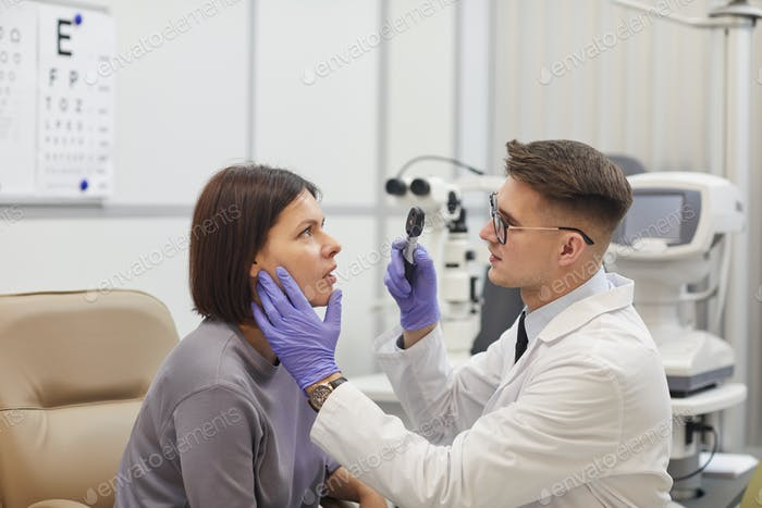 Ophthalmologist Examining Young Woman