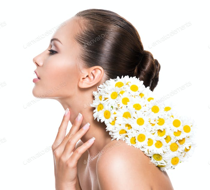 beautiful woman with posy flowers touching neck