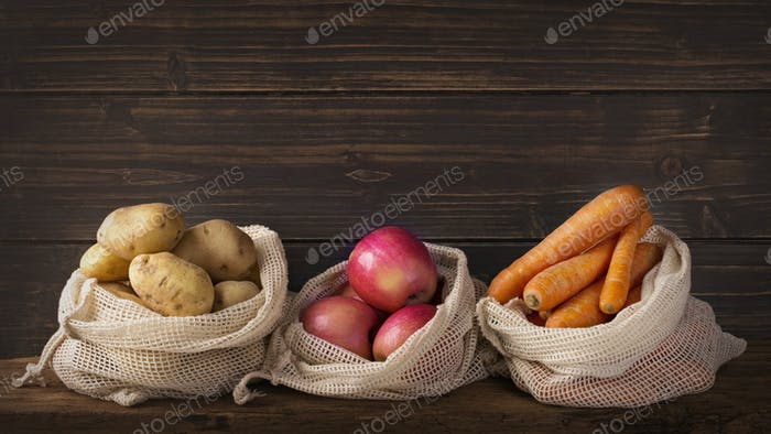 Eco friendly reusable net bags with fruits and vegetables